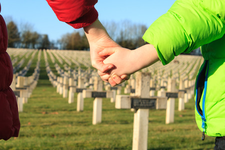 remembrance day: children walk hand in hand for peace world war 1 Stock Photo