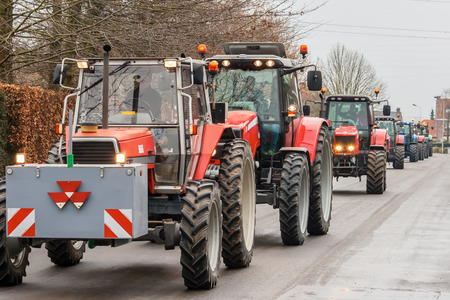 Demonstration by angry farmers with rows of tractors photo
