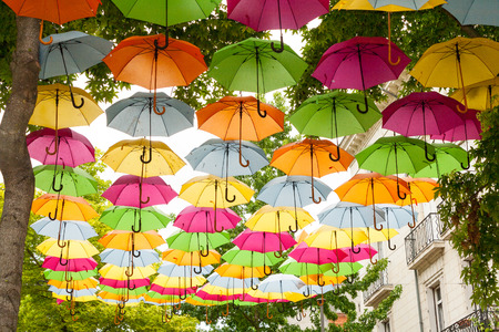 various colorful umbrellas hanging in the air