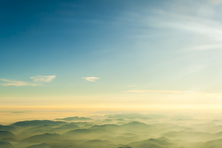 mountaintop: mountains clouds blue sky and fog photographed from on mountaintop Stock Photo