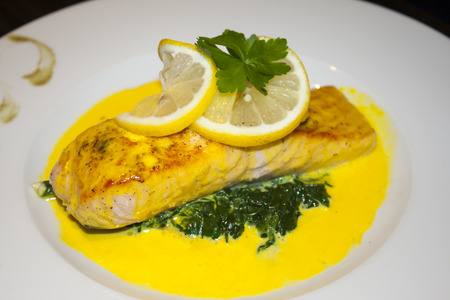 dish with salmon and a yellow sauce