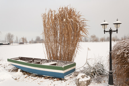 boat on a lake and snow in slovakia
