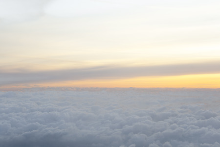 High above the clouds with beautiful sunset light