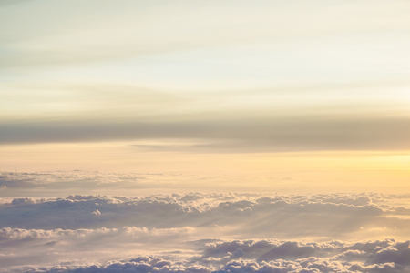 aluminum airplane: High above the clouds with beautiful sunset light