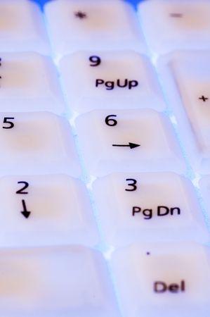 megabytes: White keyboard with blue light close up