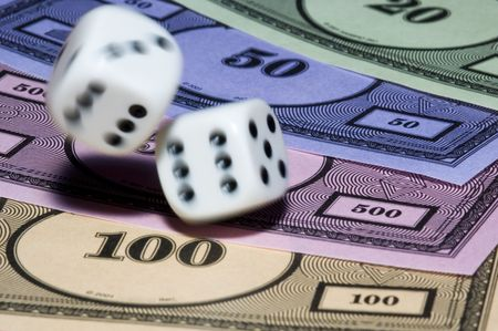 dices: Rolling dice with move effect on monopoly money