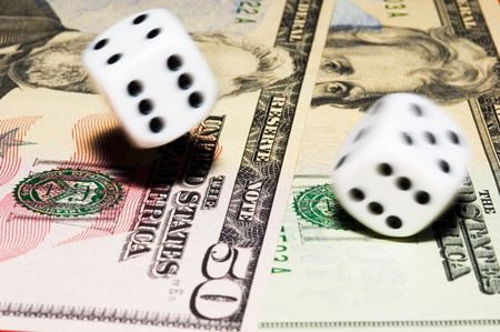 Rolling dice with move effect on dollars Stock Photo - 649900