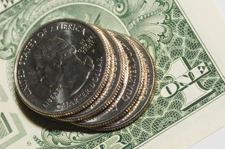 close quarters: Four quarters on dollar background Stock Photo