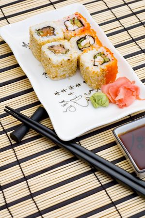 Sushi (rolls) on a plate Stock Photo