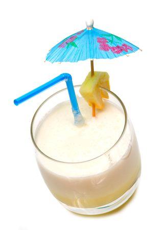 colada: Pina colada cocktail with umbrella isolated on white background     Stock Photo