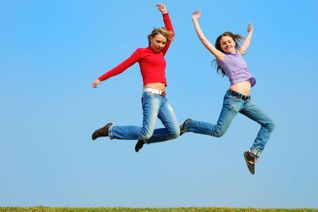 Girls jumping against blue sky Stock Photo - 860939