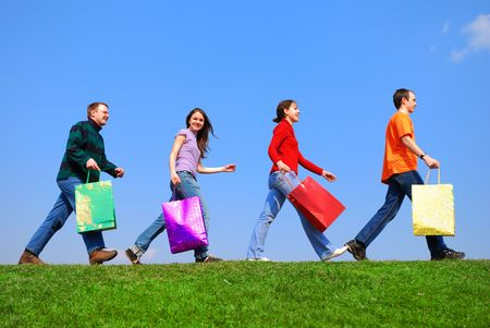 People with bags against blue sky Stock Photo - 942989