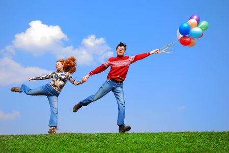 Couple with balloons against blue sky Stock Photo - 867152