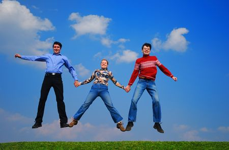 People jumping against blue sky Stock Photo - 867154
