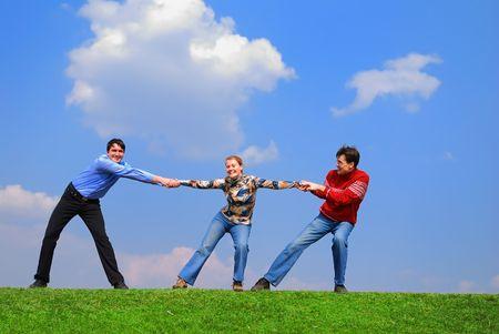 Men sharing girl against blue sky Stock Photo - 867156