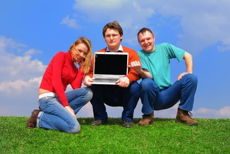 Group of people with notebook sitting on grass against sky Stock Photo - 867161