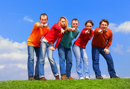 Group of people pointing to camera against blue sky Stock Photo - 867164