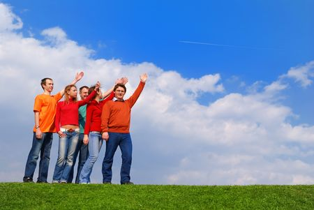 Group of people pointing to sky with clouds                 photo