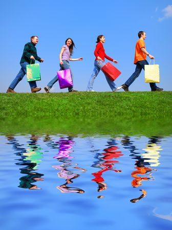 People with bags against blue sky with reflection on water Stock Photo - 874207