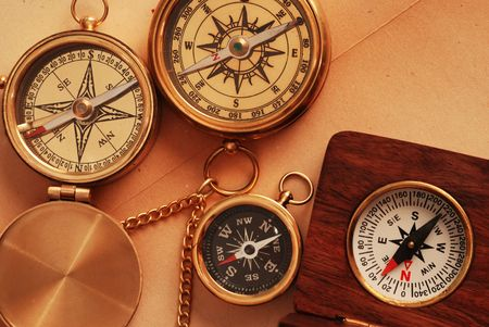 Four antique compasses over old map background Stock Photo - 936839