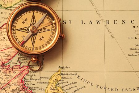 Antique brass compass over old Canadian map background Stock Photo - 936842