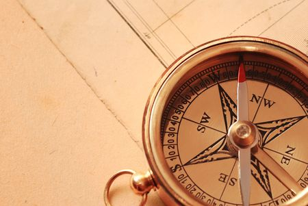 Antique brass compass over old map background Stock Photo - 951088