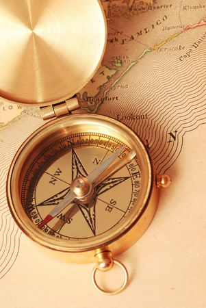 Antique brass compass over old map background Stock Photo - 959261