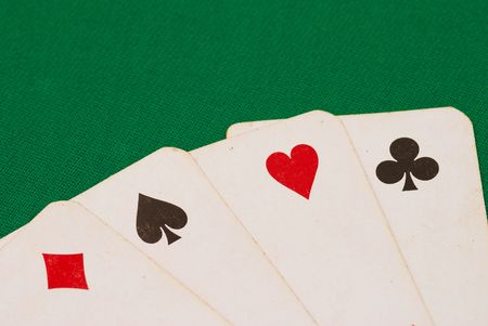 Four old playing cards on green background Stock Photo - 959284
