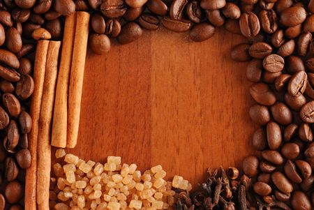 Coffee beans, cinnamon, sugar & clove background Stock Photo - 1281856