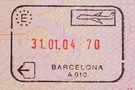 Entry stamps in passport page                                     photo