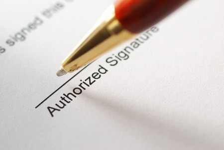 Signing a contract. Shallow depth of field. photo