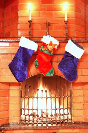 victorian fireplace: Christmas stockings on the fireplace Stock Photo