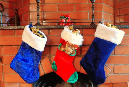 mantelpiece: Christmas stockings on the fireplace Stock Photo