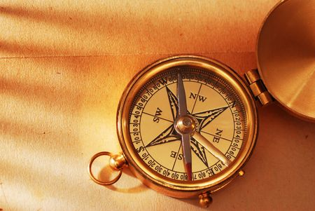 Antique brass compass over old map background Stock Photo - 2117915
