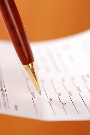 Pen & paper. Shallow depth of field. Stock Photo - 2176323