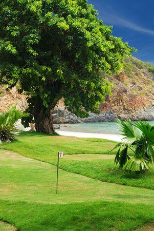 Golf field near tropical resort photo