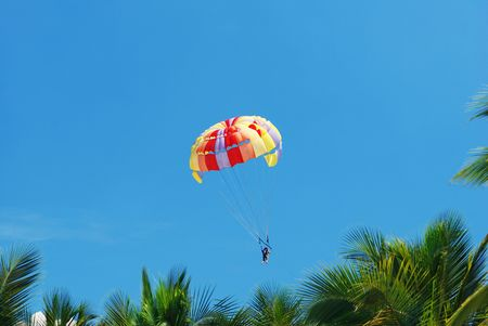 Parasailing in clear blue sky photo