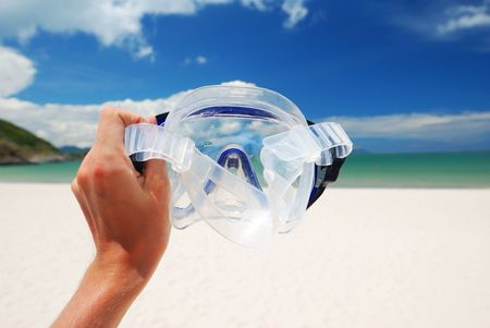 Snorkel equipment against beach and sky photo
