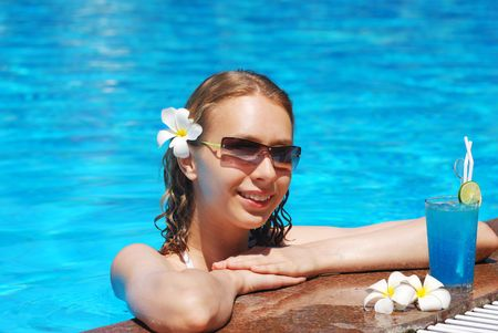 Girl in tropical pool with cocktail Stock Photo - 2514480