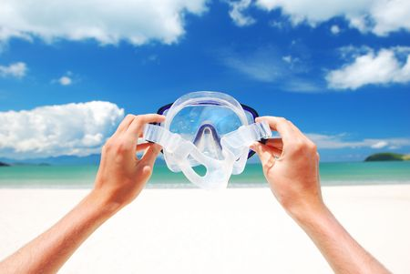Snorkel equipment against beach and sky Stock Photo - 2528438