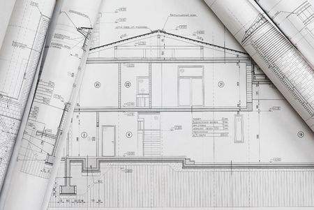architect plans: House plan blueprints roled up  Stock Photo
