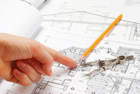House plan blueprints, designers hand photo