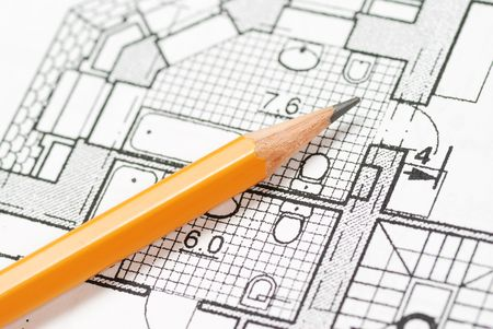 Pencil over house plan blueprints Stock Photo
