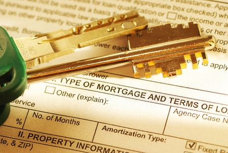 Mortgage application & keys. Shallow depth of field. Toned warm. Stock Photo