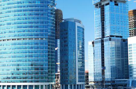 erect: Modern office building against blue sky