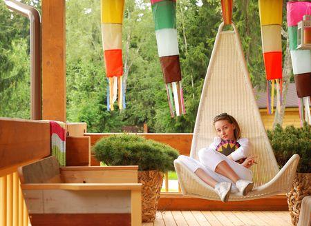 verandah: Girl relaxing on the porch
