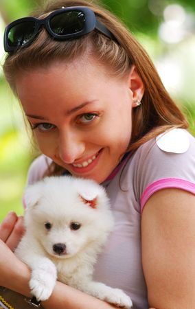 Girl with cute white puppy Stock Photo - 3367885