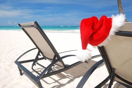 Santa's hat and chaise lounge on the beach Stock Photo - 3644092