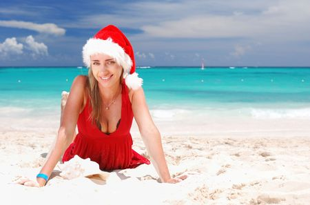 Woman on the beach in santa's hat Stock Photo - 3642314