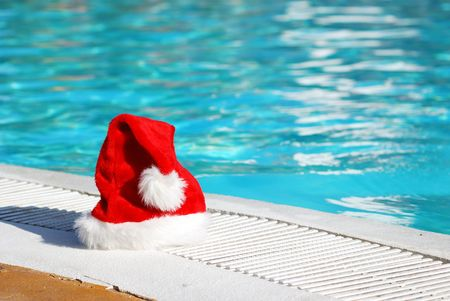 pool party: Santa hat near the swimming pool